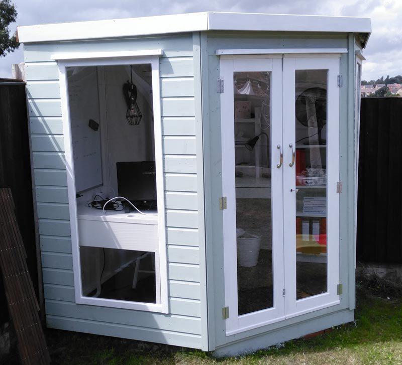 Summer house shed office soft light green and white